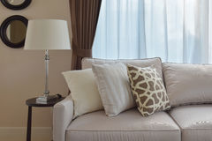 Living room design with sturdy tweed sofa with brown pillows. Living room design with sturdy tweed sofa with brown patterned pillows Stock Photos