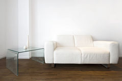 Living room detail with a white leather sofa Stock Photography