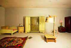 Living room in a dollhouse with lamp and retro wardrobe Stock Image