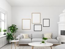 Living room with empty picture frames and fireplace. 3d rendering. 3d rendering. living room with empty picture frames and fireplace Royalty Free Stock Photos