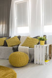 Living room with energetic yellow details Royalty Free Stock Photos