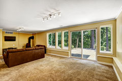 Living room with exit to backyard Stock Photography