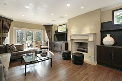 Living room with fireplace. Living room in luxury home with large fireplace Stock Images