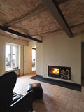 Living room with fireplace Stock Photos