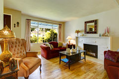 Living room with fireplace and antique chair Stock Photos