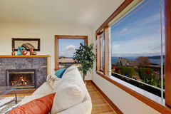 Living room with fireplace and beautiful window view Royalty Free Stock Photo