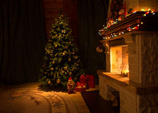 Living room with fireplace and decorated Christmas tree Royalty Free Stock Image