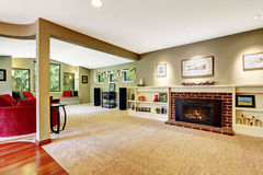 Living room with fireplace and decorated shelves Stock Images