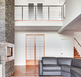 Living Room with Fireplace. And view of second story stock photo