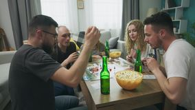 In the living room friends geeks play a strategic board game.  stock video