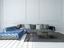 Living room with gray couch against white wall Royalty Free Stock Images