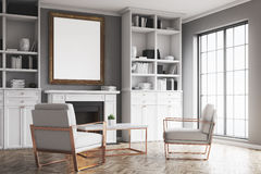 Living room with gray walls and an armchair Stock Photo
