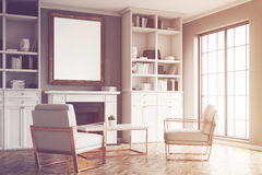 Living room with gray walls and an armchair, toned Stock Images