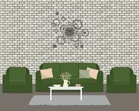 Living room with green furniture and round clock. There is a sofa and two armchairs on a brick wall background in the picture. There is also a table with Royalty Free Stock Images