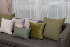 Living room with green pillow cushions on sofa. Detail of modern living room with green pillow cushions on sofa Stock Photography