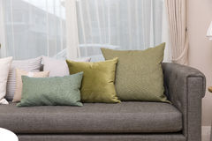 Living room with green pillow cushions on sofa. Detail of modern living room with green pillow cushions on sofa Stock Image