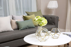 Living room with green pillow cushions on sofa. Detail of modern living room with green pillow cushions on sofa Royalty Free Stock Photo