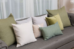 Living room with green pillow cushions on sofa. Detail of modern living room with green pillow cushions on sofa Royalty Free Stock Image