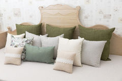 Living room with green pillow cushions on sofa. Detail of modern living room with green pillow cushions on sofa Stock Images