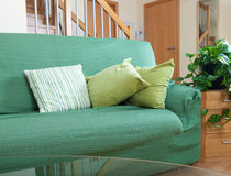 Living room with green sofa and glass table Royalty Free Stock Photography