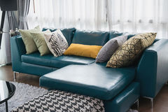 Living room with green sofa and pillows Stock Photography