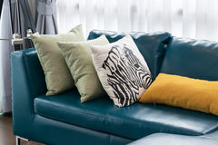 Living room with green sofa and pillows Royalty Free Stock Image