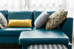 Living room with green sofa and pillows Stock Images