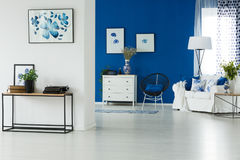 Living room with hallway. Spacious white and blue living room connected with cozy hallway Stock Photography