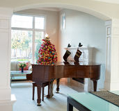Living room with holiday decorations during bright daylight Stock Photo