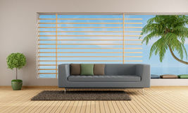 Living room of a holiday villa. Wit blue sofa and big window - rendering Royalty Free Stock Images