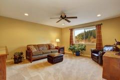Living room iinterior with sofa, carpet floor Royalty Free Stock Image