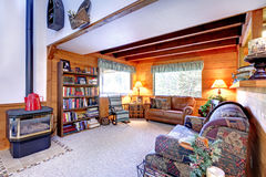 Living room interior with antique fireplace in log cabin house Royalty Free Stock Photos