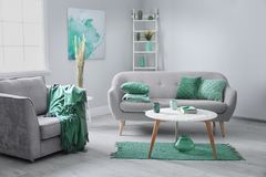 Room interior with comfortable armchair and sofa. Mint color decors. Living room interior with comfortable armchair and sofa. Mint color decors royalty free stock images