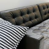 Living room interior, dark leather sofa with soft pillow stock photo