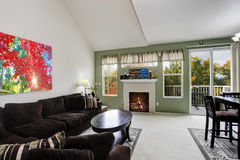 Living room interior with fireplace and walkout deck Royalty Free Stock Photos