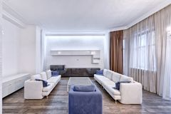 Living room interior in modern house. Russia Moscow - Modern interior design living room, urban real estate Royalty Free Stock Images