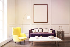 Living room interior with purple sofa, toned. Interior of a living room with purple sofa, yellow armchair and a white coffe table. Concept of comfortable Stock Image