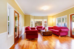 Living room interior with red sofas at the horse farm Stock Photo