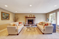 Living room interior in soft ivory with cozy fireplace Stock Photo