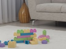 Living room interior with toy bricks on the carpet Royalty Free Stock Images