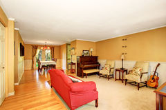 Living room interior with vintage furniture, antique piano. Connected to dining area. Royalty Free Stock Photo