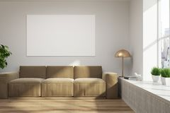 White loft living room, brown sofa, poster. Living room interior with white walls, a wooden floor, a beige sofa and a horizontal poster hanging above it. 3d Stock Photos