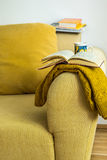 Living room interior yellow corduroy couch with cushion, knitted Royalty Free Stock Image