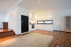 Living room with kitchen Stock Images