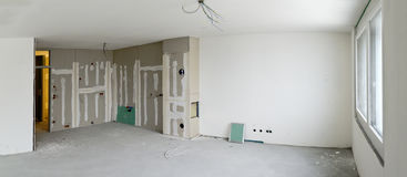 Living room with kitchen corner under construction. Living room with kitchen corner made by plaster-boards at a residential building under construction Royalty Free Stock Photography