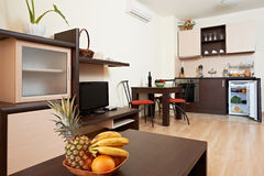 Living room with kitchen interior Royalty Free Stock Photo