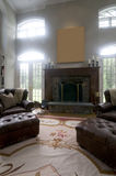 living room leather chairs fireplace Stock Photo