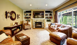 Living room with leather couch and fireplace Stock Photo