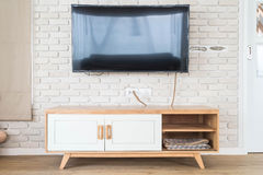 Living room with led tv on brick wall and wooden table Stock Photography