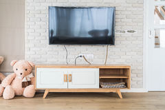 Living room with led tv on brick wall and wooden table Royalty Free Stock Photo